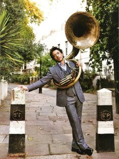 It doesn't even matter if he can play the tuba, because he looks perfect with it. [32 Reasons Why RDJ is the Greatest Man Who Ever Lived]