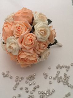 Beautiful bouquet made with peony and roses in peach and ivory.