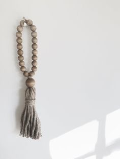 """Give your guests a wordless welcome with a fun beach hippie welcome tassel! About this Welcome Tasel: Hangs approx. 17"""" long Hand made jute..."""