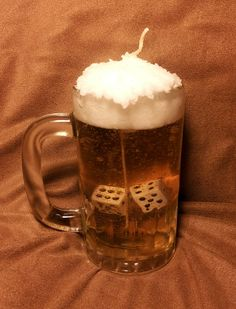 """Beer gel candle with Dice-Mug is 6"""" tall with beer colored gel, parafin wax head and rainforest scented"""