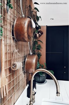 3f0031ac1 Copper pans add warmth to a modern rustic kitchen with exposed brick and  marble wortops and