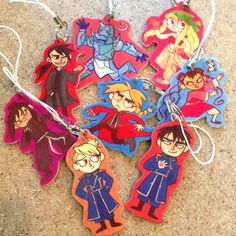 Ink-jet shrinky-dink phone charms, come with keyring and cell phone charm strap! Featuring characters from the anime Fullmetal Alchemist: Brotherhood.  Available characters: Edward Elric Alphonse Elric Winry Rockbell May Chang Ling Yao/Greed Lanfan Roy Mustang Riza Hawkeye.    If anyone gets this for me I would like Alphonse Elric.....