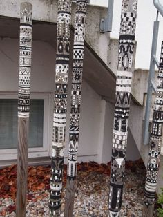 Decorated bamboo poles ~ I want to do this with stacked tin cans! Wouldn't THAT be wild?