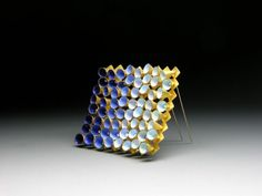 Brooch, Moveable cones, 2012, 18ct Gold and shaded enamel, 58 x 58 x 11mm by Jacqueline Ryan