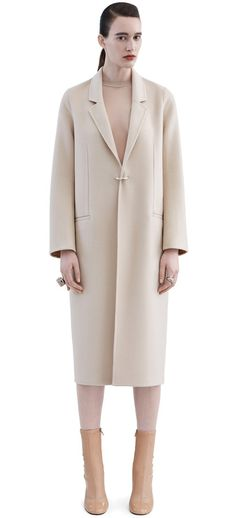 Foin doublé nougat beige coat in a soft cashmere blend with a front d-ring closure #AcneStudios #AcneStudiosFW15