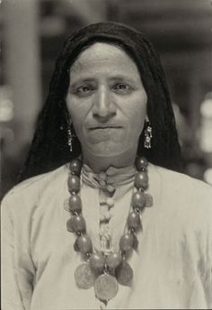 Syrian Arab immigrant at Ellis Island, New York City, USA; by Lewis W. Hine.  She has similar facial features to my Syrian-American side of the family (-Isa)
