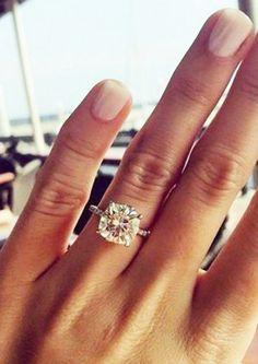 A cushion-cut diamond engagement ring