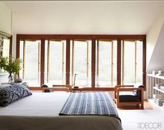 """Western Union: """"In Roth and Emily Martin's bedroom, the Jacques Adnet armchairs are from Hedge, and the rug is by Mark Nelson Designs; the shelving is original."""""""