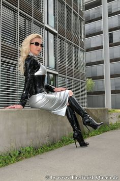 Heike The Fetish Queen. Black Vinyl Mini Jupeé & Tall Boots. & Silver Dress.