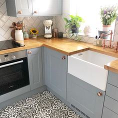 It's the amazing patterned tiles in the kitchen again. Which contrast brilliantly against the grey units and wooden worktops in the kitchen Kitchen Room Design, Kitchen Interior, Kitchen Decor, Wooden Worktop Kitchen, Cottage Kitchen Cabinets, Upcycled Kitchen Cabinets, Kitchen Styling, Home Kitchens, Kitchen Remodel