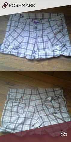 Plaid shorts Brown and orange plaid shorts. Back pockets have button flaps. Slash pockets and belt loops. Cuffs can be unbottomed and rolled down for more length. 1st Kiss Shorts