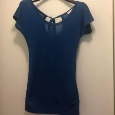 Blue Top This comfortable blue top goes well with many outfits! It is a size medium and I believe the material is cotton (the tag is no longer attached). It's a comfortable blue top that you will look great in! Let me know if you are interested! :) one clothing Tops