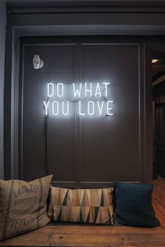 'Do What You Love' neon light sign on the office walls in NYC.