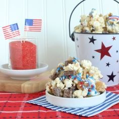 S'mores Popcorn Munch - White chocolate covered popcorn tossed with golden grahams, chocolate chunks, and marshmallows. You won't be able to stop!!!
