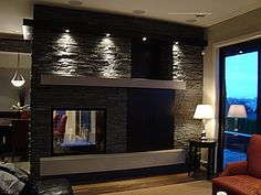 Double sided fireplace. Love the stone. Would make a full wall between living area and bedroom.