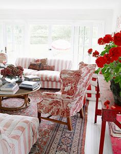 faded red stripes, posh rug, toile, red geraniums...