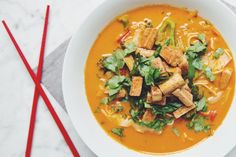 thai curry, cilantro, lime, fresh veggies, fried tofu, noodles... well that's practically heaven in a bowl! Make this quick and easy golden curry noodle soup asap.