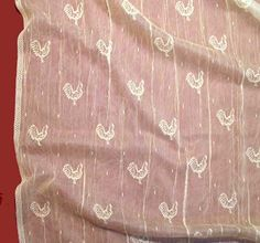 "The ""Rooster"" image all over the place is designed as a kitchen lace curtain.  Available for $17.95 per yard."