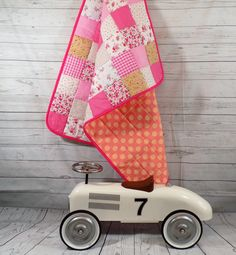 A personal favourite from my Etsy shop https://www.etsy.com/uk/listing/476625137/shabby-chic-baby-quilt-pink-baby-quilt