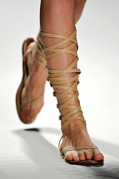 Tan leather knee high sandals.