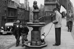 10 signs of old Edinburgh you can still see today Visit Edinburgh, Edinburgh Scotland, Scotland Travel, Greyfriars Bobby, Research Images, Skye Terrier, Little Shop Of Horrors, Urban Legends, Vintage Photographs