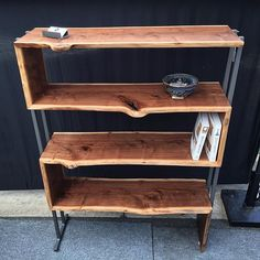 I am proud of this continuous grain walnut bookcase with grey steel supports…