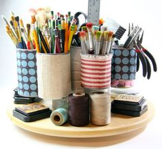 Wire several small or medium tin cans around a larger central coffee can and place on a Lazy Susan for swiveling access to art supplies you want to keep within arm's reach. Get the tutorial at Cynthia Shaffer.