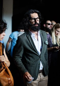 Check out On the Street...In the Crowd, one of the exclusive pictures shot by Scott Schuman in Milan for Faces by The Sartorialist.