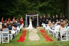 Rose petal swirls adorned this beautiful outdoor ceremony site. #rosepetalaisle #redweddings @Vecoma at the Yellow River