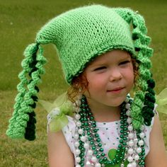 This hat crocheted in the Tunisian crochet knit stitch, it has the look and feel of stockinette stitch.  It features three spiral Curly-Q's on each corner of the hat. These hats also make excellent photo props and gifts.