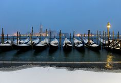 Snow-covered gondolas, seen, moored in Venice's lagoon, Italy, Saturday, Dec. 19, 2009. Cold weather with temperatures below zero and heavy snowfall affected Italy and central Europe Saturday.