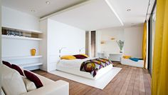 Villa WIK: White lacquer bedrooms get an infusion of color from mod Missoni textiles.