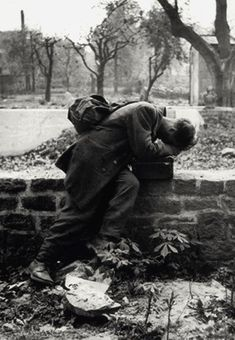 A German soldier finally arrives home, only to find his family gone. Photograph by Tony Vaccaro, 1946.