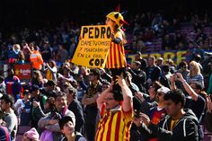 FC Barcelona supporters cheer their team prior to the La Liga match between FC Barcelona and Rayo Vallecano de Madrid at Camp Nou on March 8, 2015 in Barcelona, Catalonia.