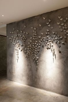 Gallery - Vivarium / HYPOTHESIS + Stu/D/O Architects - The feature wall of restaurant - porcelain butterflies on grey - calmness. Project Description Vivarium is a new restaurant in Bangkok, Thailand, constructed within a decommissioned warehouse owned by Plaster Art, Plaster Walls, Apartment Interior Design, Best Interior Design, Appartement Design, Wall Sculptures, Textured Walls, Wall Murals, Home Decor