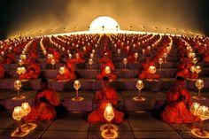 Buddhist monks' ritual before starting the paper lanterns. Pathum Thani province, Thailand.