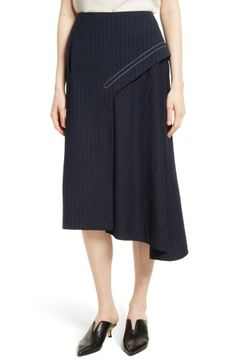 Free shipping and returns on Tibi Delmont Draped Midi Skirt at Nordstrom.com. A draped bias panel adds asymmetrical kick to this cleverly twisted pinstripe-suiting skirt full of inimitable cool.