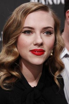 Soft vintage waves and bold red lips. (Scarlett).