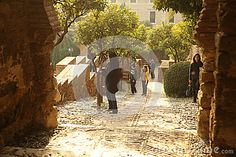 Photo about Peoples taking pictures, relaxing and enjoing a beautiful december afternoon in Alcazaba Malaga Andalucia Spain. Picture taken in december Image of flags, architecture, groups - 69955532 Andalucia Spain, Malaga, Taking Pictures, Editorial Photography, December, Relax, Architecture, Interior, Image