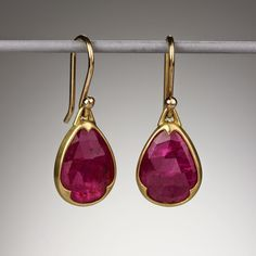 This stunning pair of yellow gold earrings features two beautiful bezel set pear-shaped rose cut rubies in a deep fuchsia color with Gabriella Kiss' signature scalloping.The total length of these Gabriella Kiss earrings is approximately Bar Stud Earrings, Ruby Earrings, Ruby Jewelry, Gold Jewelry, Diamond Earrings, Jewelry Accessories, Fine Jewelry, Jewelry Design, Jewellery Box