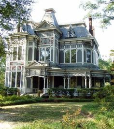 Antique House with big porch? It just looks like a fairy tale!