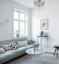light filled room with a mint green sofa