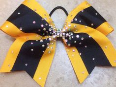 This black and yellow/gold grosgrain bow has an AB rhinestone design and was inspired by Top Gun Allstars.