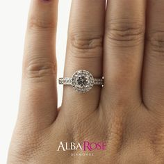 Alba Rose - D32565 cluster engagement ring design with 0.70ct centre round diamond. http://www.albarose.com/product/d32565-a_51602