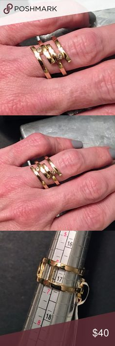 """Elizabeth and James Connolly Ring Modern and minimalist, this sculptural ring features bands of openwork vermeil punctuated with two white topaz stones for subtle sparkle. 1/2"""" width Sterling silver with 24k-gold plate with white topaz stones Beautiful! NWT Elizabeth and James Jewelry Rings"""