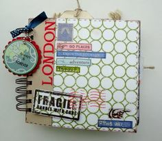Among other details, I really like how she incorporated the Tim Holtz Post Card stamps into her design.