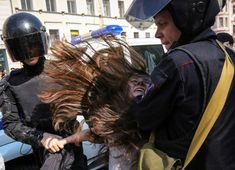 Police officers detain an opposition protester during a May Day rally in Saint Petersburg, Russia May REUTERS/Igor Russak May Days, Twitter Trending, May 1, Trending Topics, Celebs, Celebrities, Top Photo, Police Officer, Editor