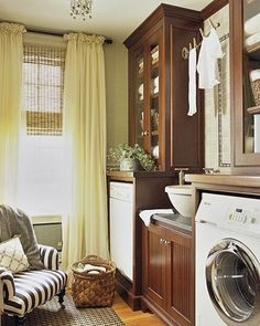 HELLO, never thought of putting a comfy chair in the laundry room. love it.