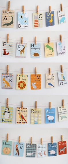 Illustrated alphabet cards hung in a children's room
