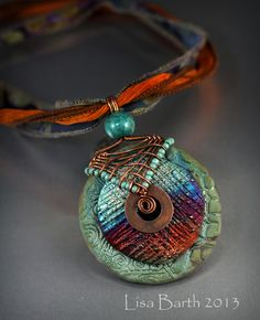 Wire work over some beautiful raku pieces from a gal I just met at the bead show.  She has beautiful work, I had to wire one up.